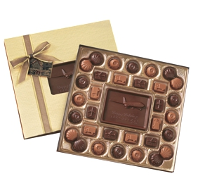 Medium Custom Chocolate Delights Gift Box - Made from milk and dark Swiss chocolate, this gift box is large enough for a group or deserving individual. The customized centerpiece is nestled amongst 32 chocolate pieces.